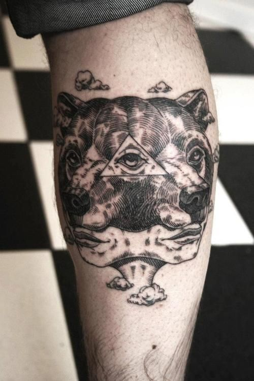 3D eyes and bear tattoo on arm