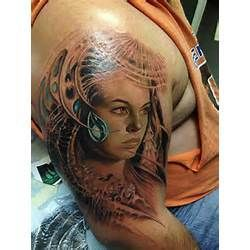 3D girl face tattoo on arm
