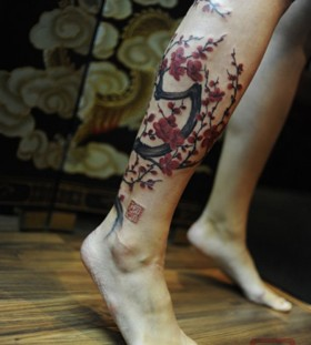 Adorable big tree tattoo on leg
