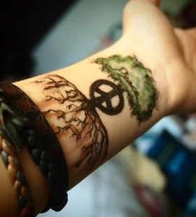 Adorable black and green tree tattoo on arm