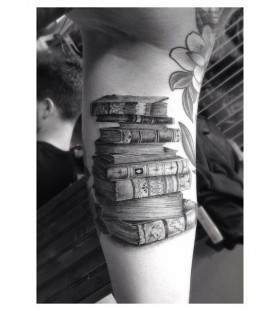 Adorable black book tattoo on arm