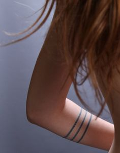 Adorable black line tattoo on arm