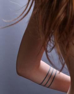 Adorable black line tattoo on arm