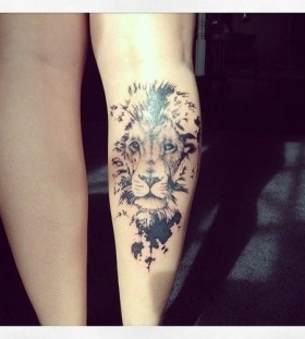 Adorable black lion tattoo on leg