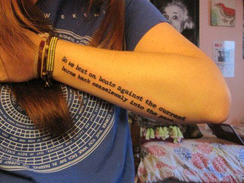 Adorable black quote tattoo on arm