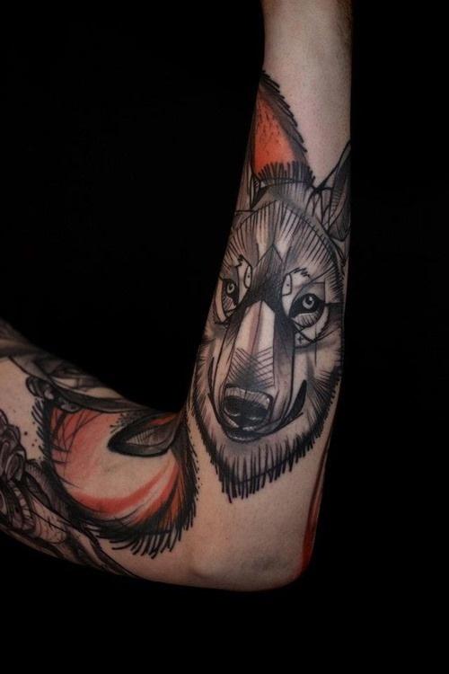 Adorable black wolf tattoo on arm
