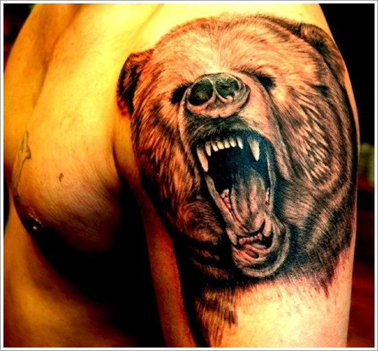 Adorable brown bear tattoo on arm