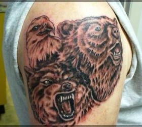 Adorable brown bear tattoo on shoulder
