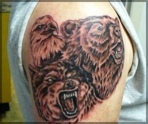 Adorable brown bear tattoo on shoulder