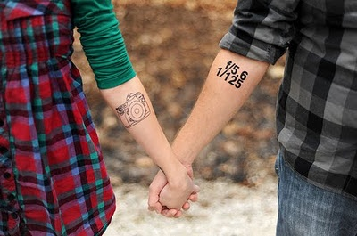 Adorable couple camera tattoo on arm