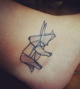 Adorable dinosaur origami tattoo on leg