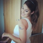 Adorable girl's moon tattoo on shoulder