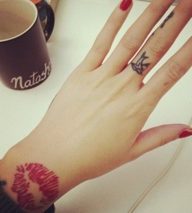 Adorable nails and lips tattoo on arm