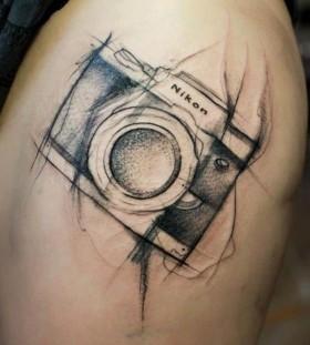Adorable nikon camera tattoo on leg