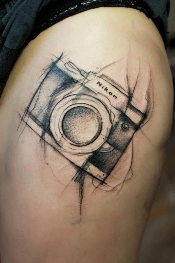Adorable nikon camera tattoo on leg