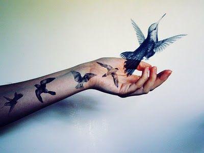 Adorable realistic bird tattoo on arm