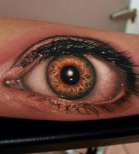 Adorable realistic eye tattoo on arm