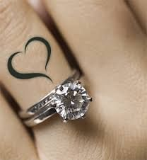 Adorable ring and heart tattoo