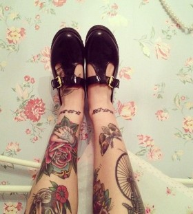 Adorable shoes and rose tattoo on leg