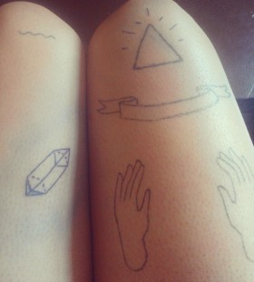 Adorable simple crystal tattoo on leg