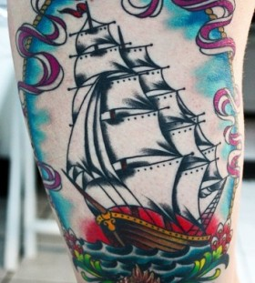 Adorable white and blue ship tattoo on leg