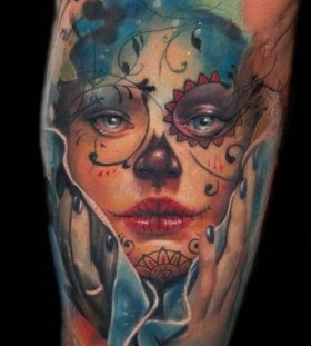 Adorable women face tattoo on leg
