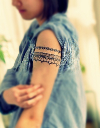 Adorable women lace tattoo on arm