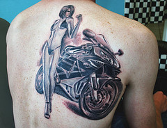 Adorable women's bicycle tattoo on back