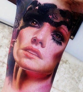 Adorable women's face tattoo on arm