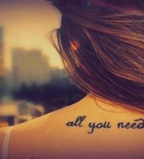 All you need is love quote tattoo on arm