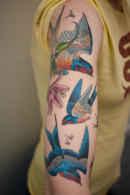 Amaizing hand blue bird tattoo