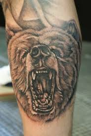 Amazing angry bear tattoo on leg