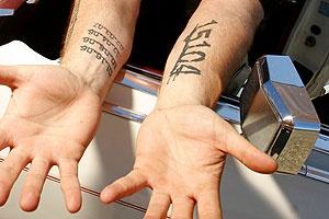Amazing black number tattoo on arm
