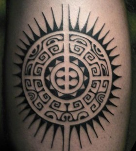 Amazing black sun tattoo on leg