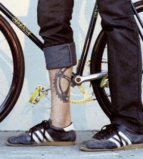 Amazing boy bicycle tattoo on leg