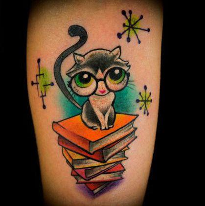 Amazing, cute big eyes cat book tattoo on arm