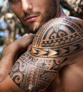 Amazing eyes men's tribal tattoo on arm