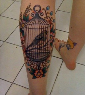 Amazing flower and bird tattoo on leg