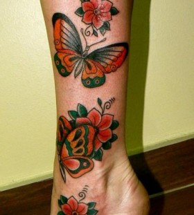 Amazing flower and butterfly tattoo on leg
