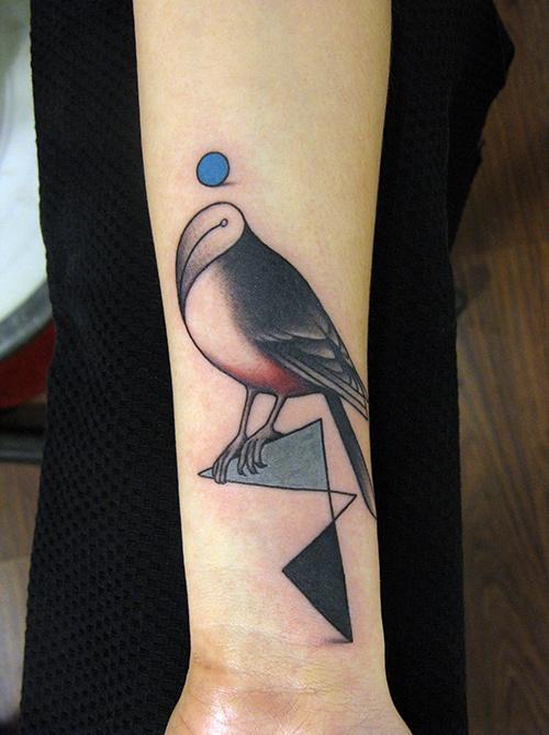 Amazing forms bird tattoo on arm