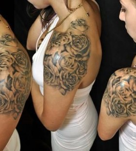 Amazing front rose tattoo on shoulder