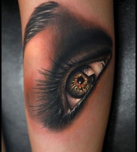 Amazing green eye tattoo on arm