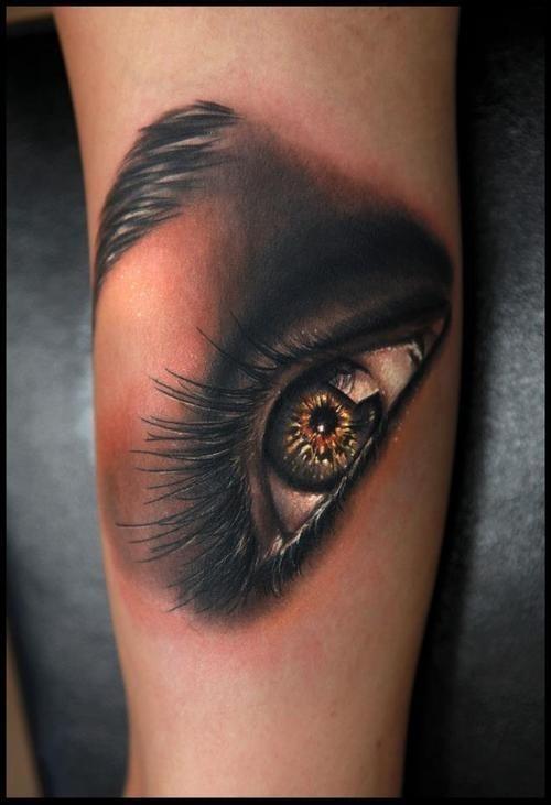 Amazing green eye tattoo on arm