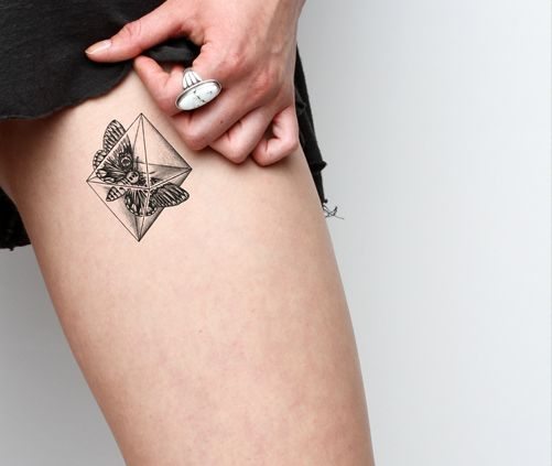 Amazing insect crystal tattoo on leg