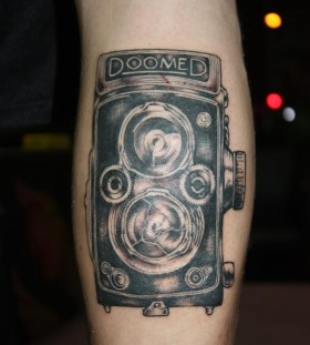 Amazing old camera tattoo on leg