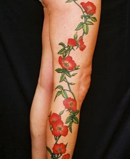 Amazing red rose full leg tattoo
