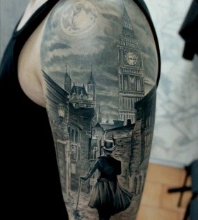 Amazing town view and moon tattoo on shoulder