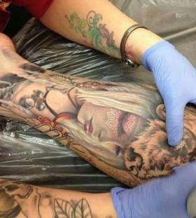 Amazing women's face tattoo on leg