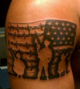 American flag soldier tattoo on arm