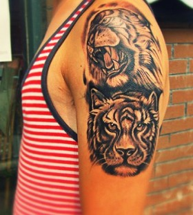 Angry and smart tiger tattoo on arm